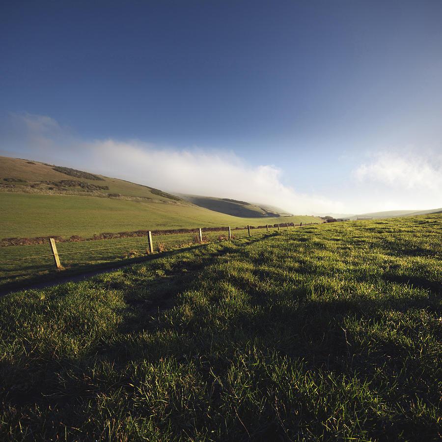 Fence on mounatin aginst sky Photograph by s0ulsurfing - Jason Swain