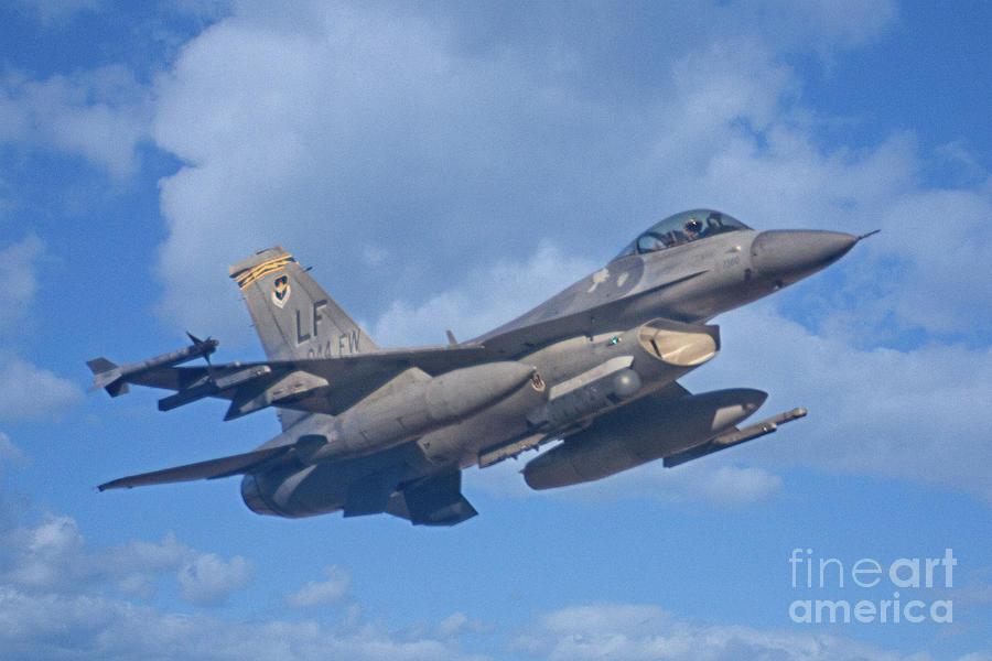 F-16 Photograph - Fighting Falcon by Bob Hislop