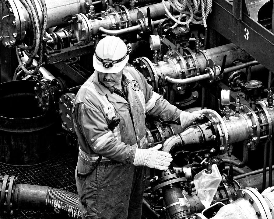 Fill 'er Up -- Workman Aboard a Fuel Tanker in Halifax, Nova Scotia by Darin Volpe