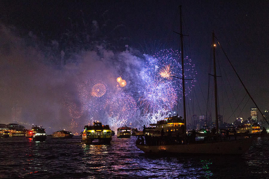 Firework display in New York Bay with boats in the foreground Photograph by Photographed by Victoria Phipps ©