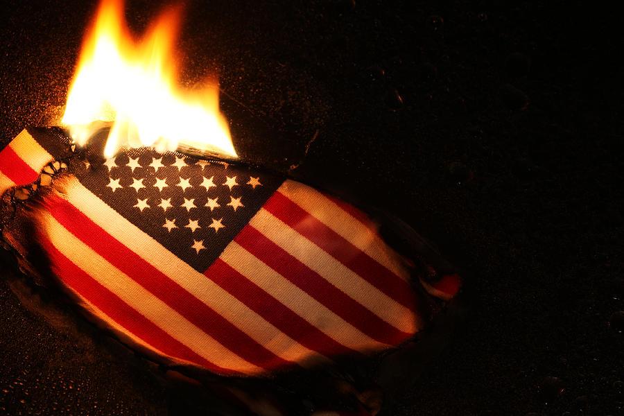 Flag Burning Photograph by DanBrandenburg