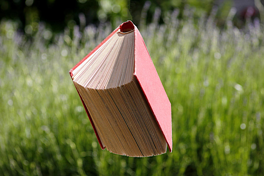 Floating Book Photograph by Gregoria Gregoriou Crowe fine art and creative photography.