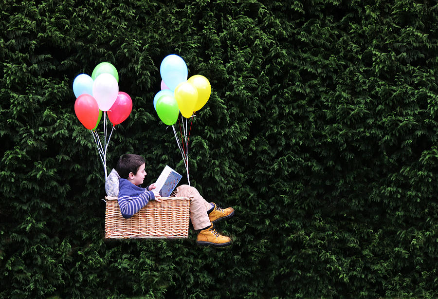 Flying with a good book Photograph by Natalia Crespo