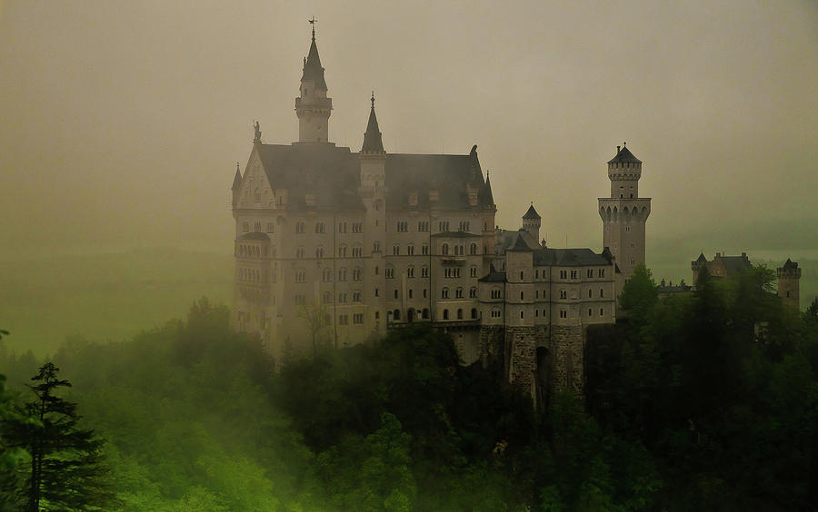 Fog Rolls Over The Neuschwanstein Castle Photograph