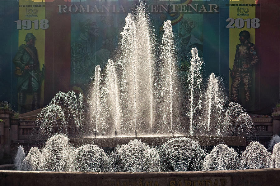 Bucharest Photograph - Fountain and Centenary Mural in Bucharest, Romania by Barry O Carroll
