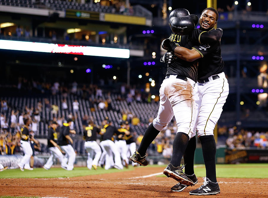 Francisco Cervelli and Gregory Polanco Photograph by Jared Wickerham