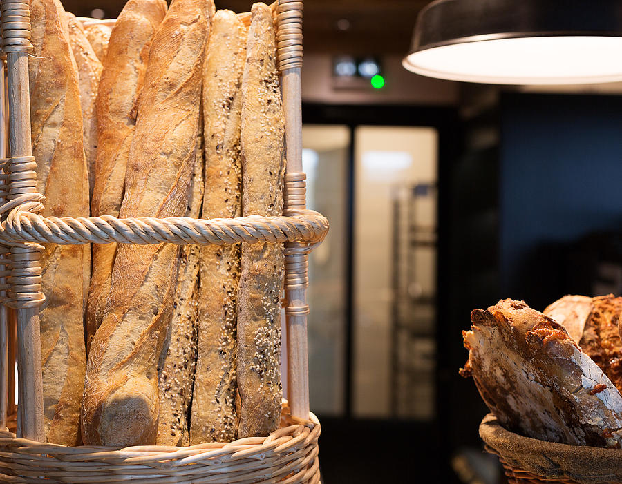 French baguettes in a bakery Photograph by Jean-Marc PAYET