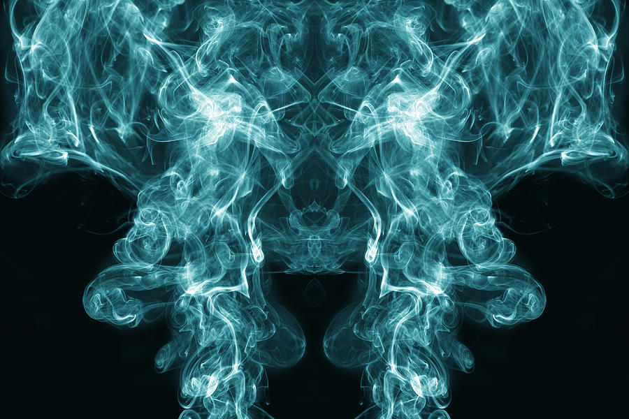 Full frame of forms and figures of smoke of color blue and white in ascending movement   on a black background Photograph by Jose A. Bernat Bacete