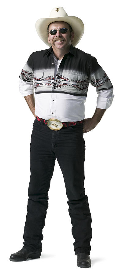 Full Length Shot Of An Adult Male In A Cowboy Shirt And Hat As He Looks At The Camera Photograph by Photodisc