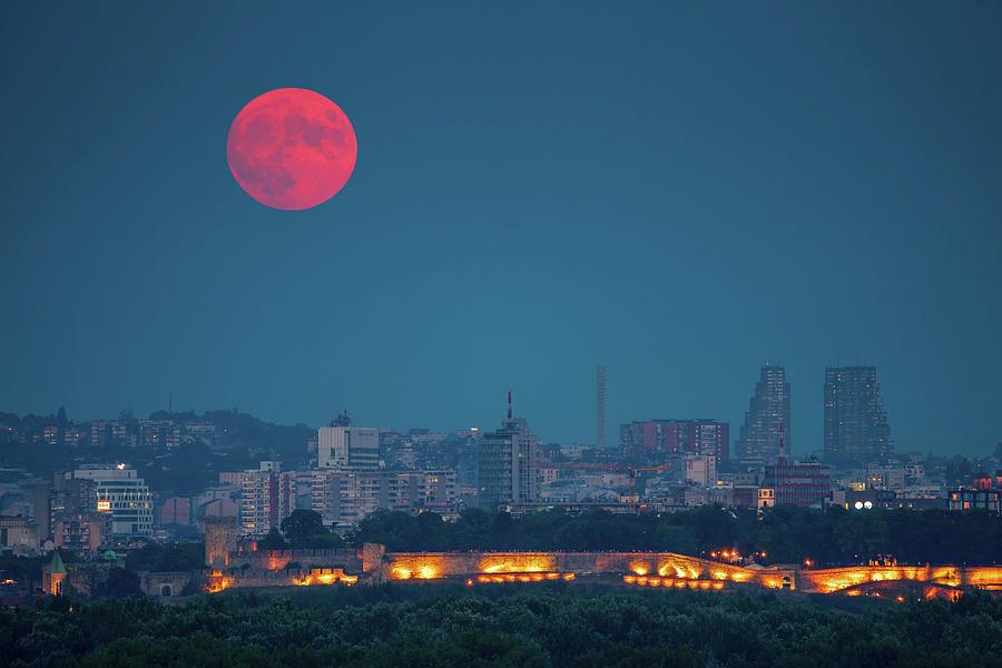 Moon Photograph - Full Red Moon over Belgrade by Dejan Kostic