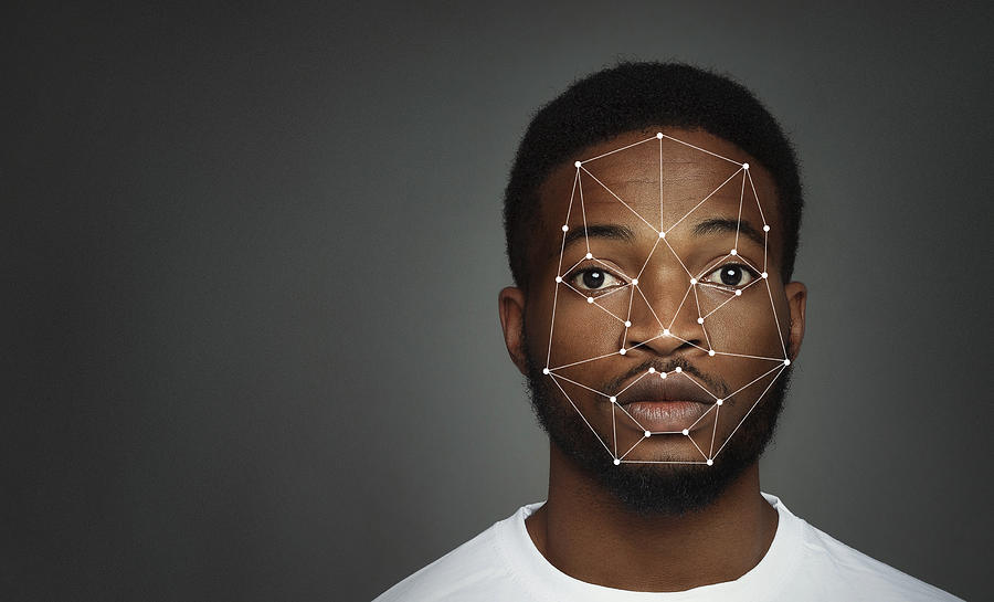 Futuristic and technological scanning of face for facial recognition Photograph by Prostock-Studio