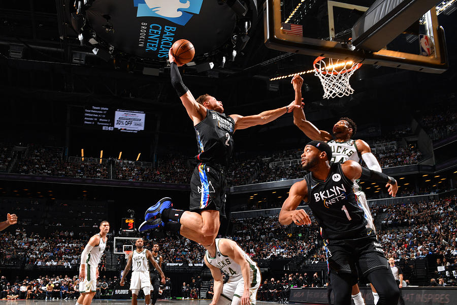 Giannis Antetokounmpo and Blake Griffin Photograph by Jesse D. Garrabrant