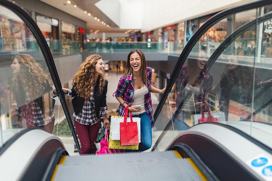 Girls having fun in the shopping center Photograph by Martin-dm