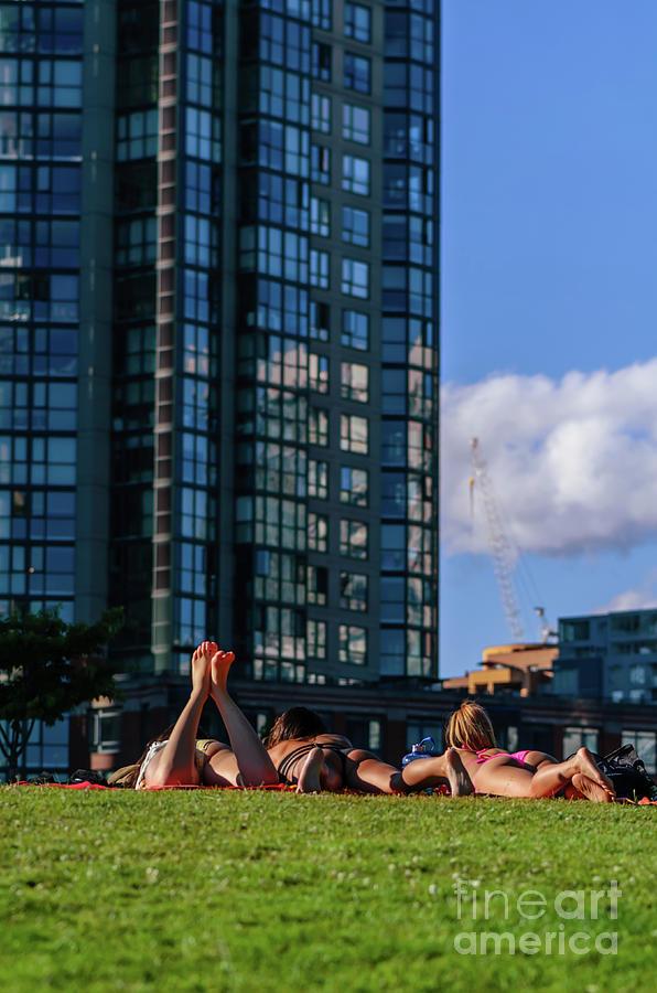 Girls Sunbathe On The Lawn Photograph