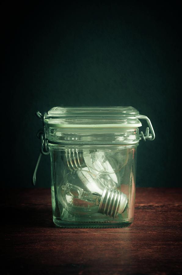 Glass Jar and Light Bulbs by Carlos Caetano