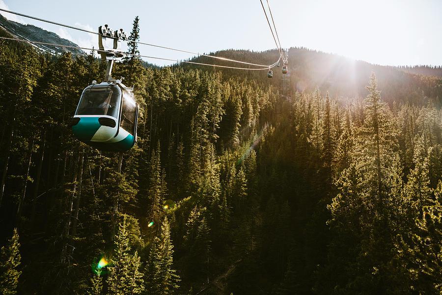 Gondola Lift Going Up Mountain in Banff Canada Photograph by RyanJLane