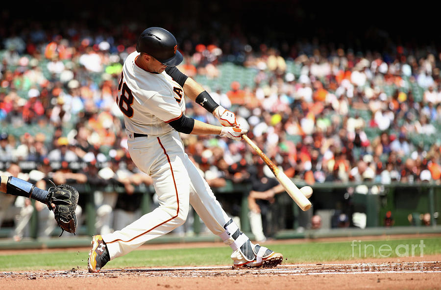 Gorkys Hernandez And Buster Posey Photograph by Ezra Shaw
