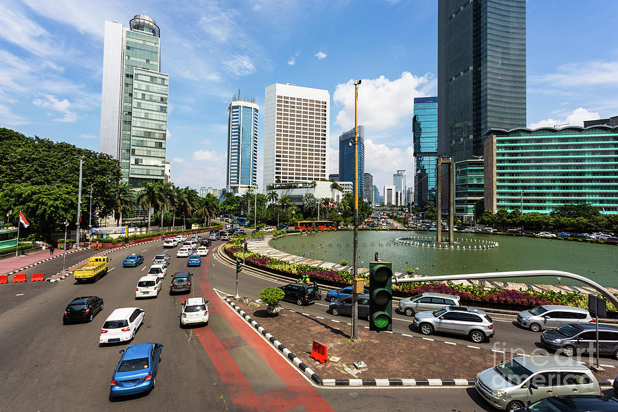 Green light on traffic in the heart of Jakarta business and down by Didier Marti
