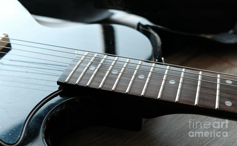 guitar fingerboard or fretboard closeup by Luca Lorenzelli