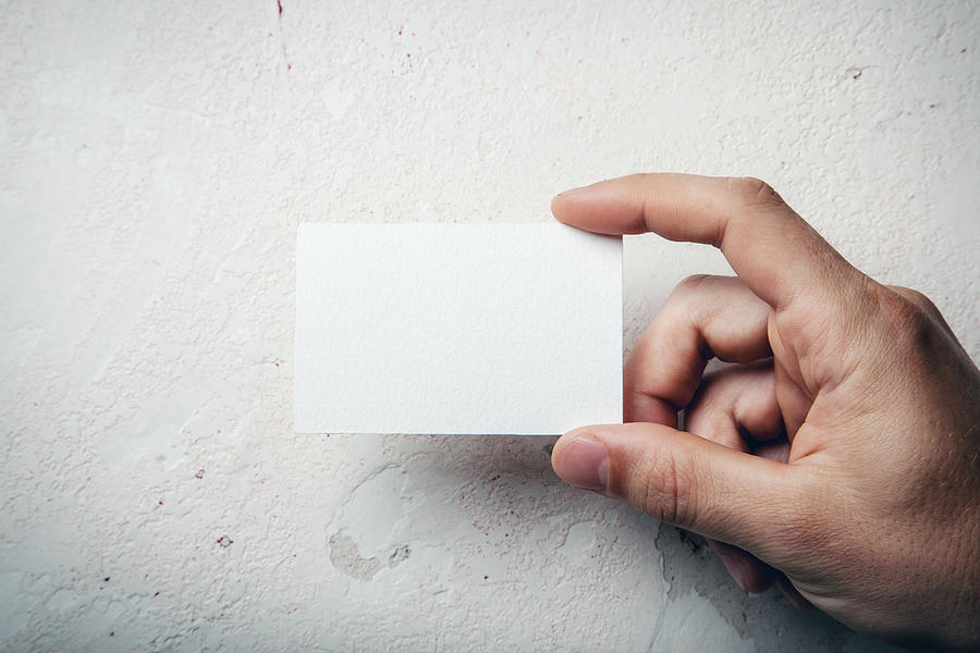 Hand holding business card Photograph by Sfio Cracho