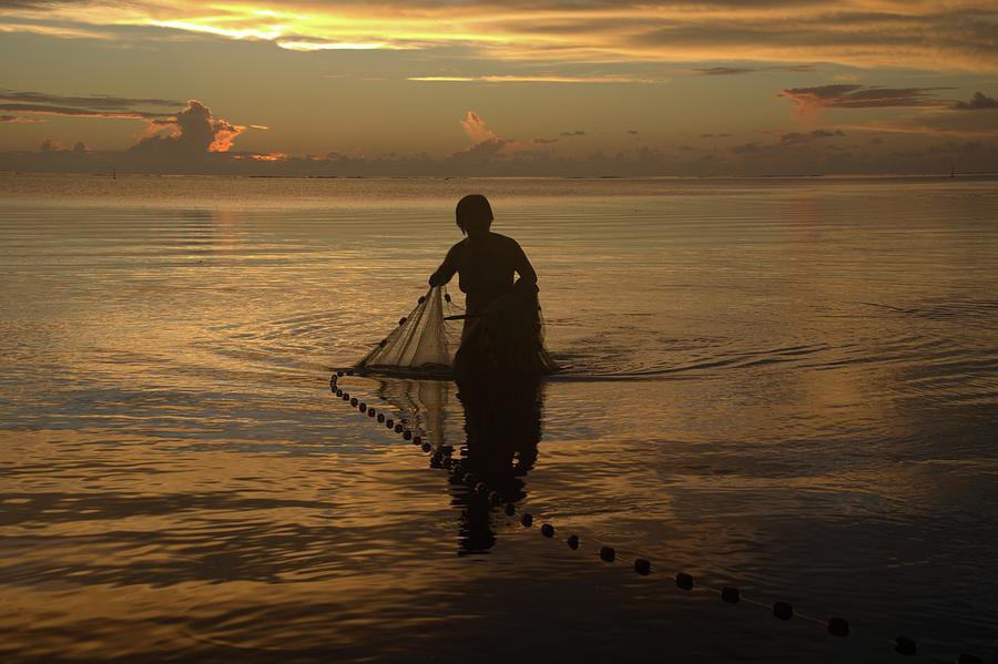 Hand Net Fishing At Sunset Tahiti Photograph