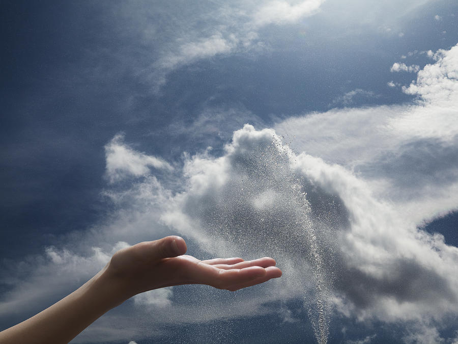 Hand of girl in the sky with fountain Photograph by Hiroshi Watanabe