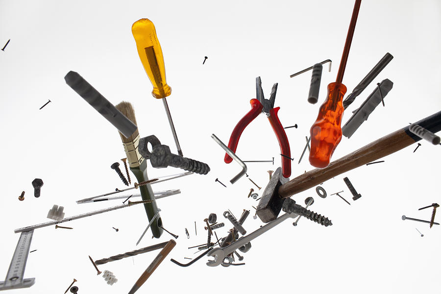 Hand tools and equipment against a white background Photograph by Dual Dual