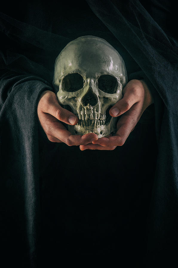 Hands Holding Skull by Carlos Caetano