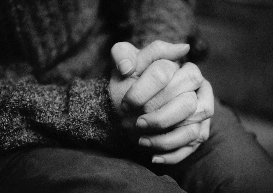 Hands together, close-up, b&w Photograph by Laurent Hamels