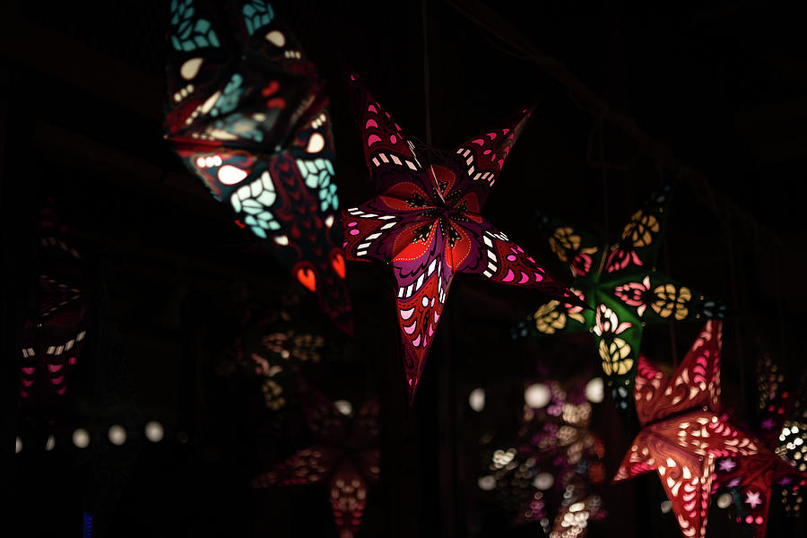 Hanging Star Lanterns Reflecting In The Glass Photograph