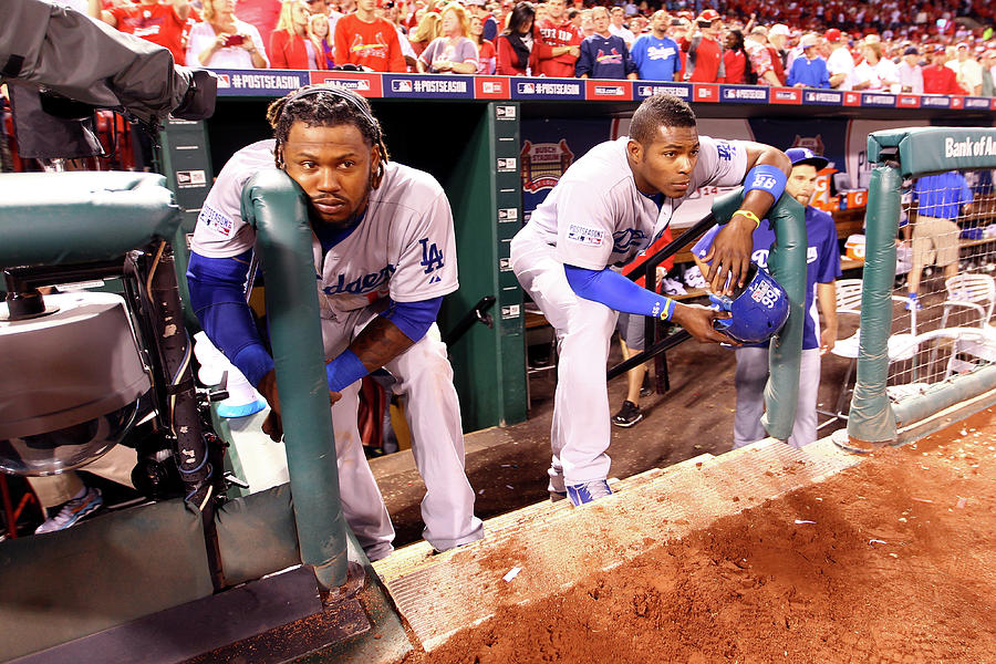 Hanley Ramirez and Yasiel Puig Photograph by Jamie Squire