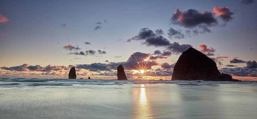 Haystack Rock On The Coast Photograph