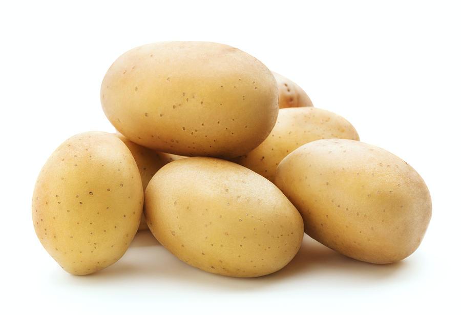 Heap Of Raw Potato Photograph by Pineapple Studio
