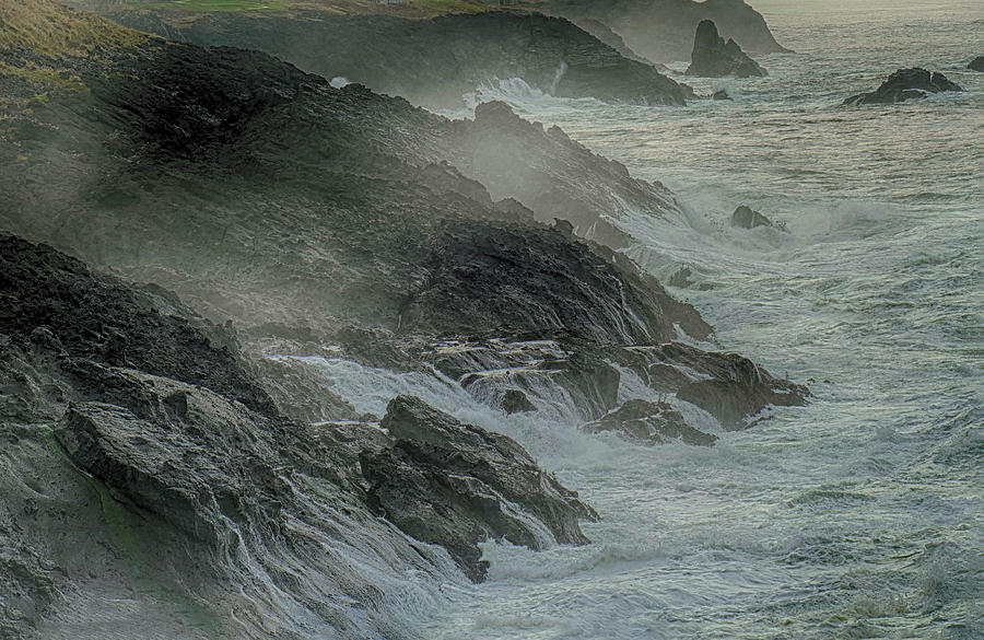 Heavy seas crash on rocks  by Steve Estvanik