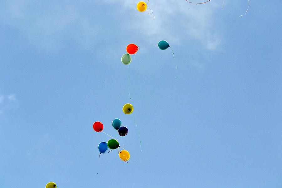 Helium balloons in sky Photograph by Valentina Cristian / FOAP