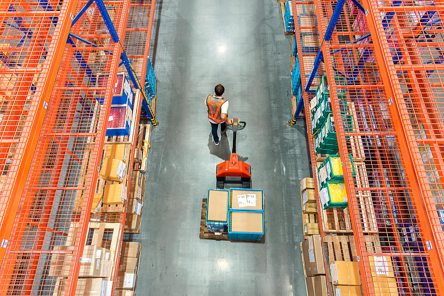High angle view of Male warehouse worker. Photograph by Kmatta