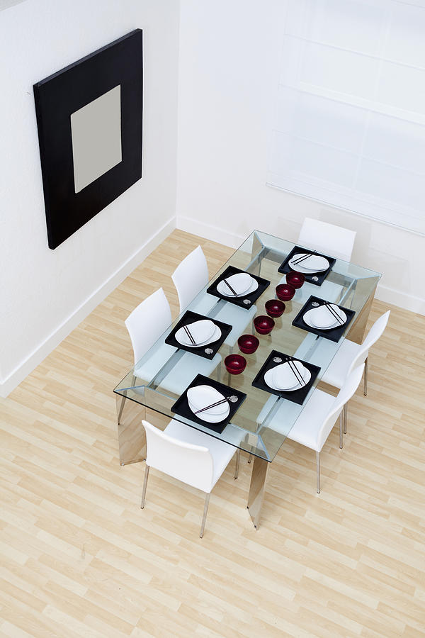 High angle view of set table and chairs in modern dining room Photograph by Camilo Morales