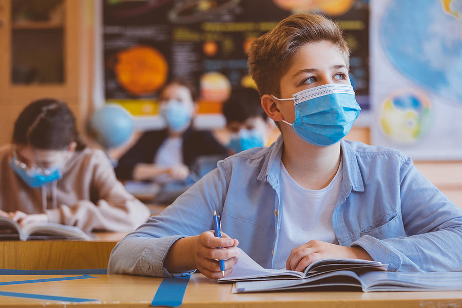 High school boy student at school wearing N95 Face masks Photograph by Izusek