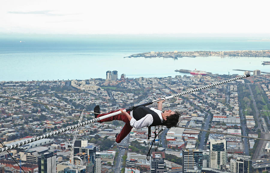 High-wire Artist Kane Petersen Performs Tightrope Walk Over Melbourne CBD Photograph by Scott Barbour