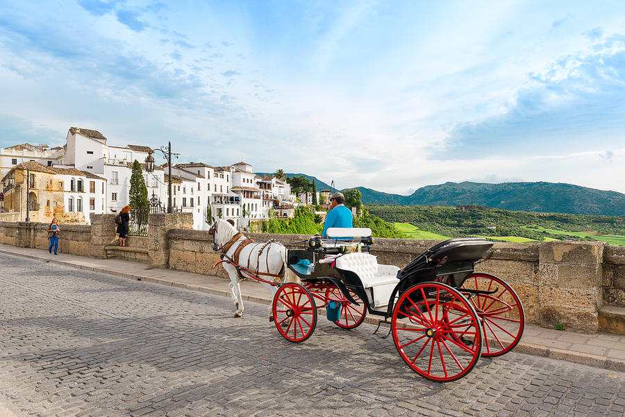 Horse drawn carriage on Puerto Nuveo in Ronda Photograph by Syolacan