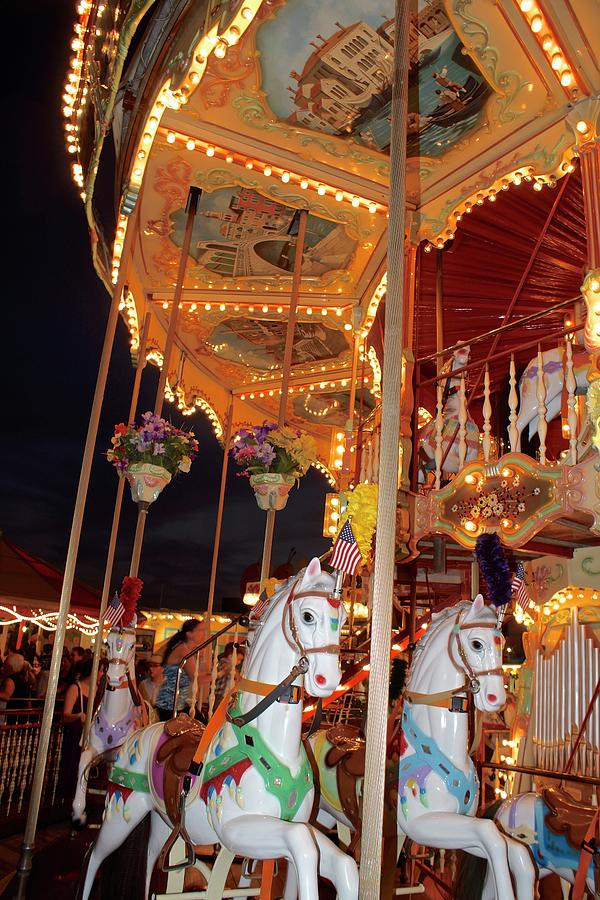 Horses And Antique Merry-go-round. Photograph