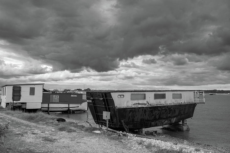 House Photograph - House Boats under a gloomy sky by Nick Lewis