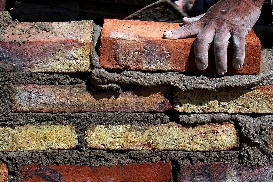 Human hand building brick wall Photograph by Memo Vasquez