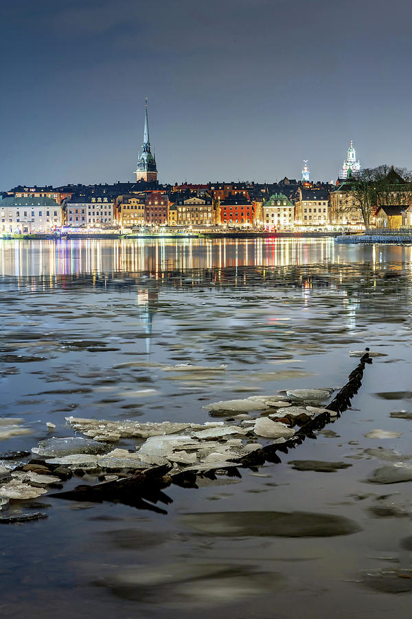 Stockholm Photograph - Ice, Shipwreck, and Stockholm Gamla Stan fantastic reflection in the Calm Baltic Sea by Dejan Kostic
