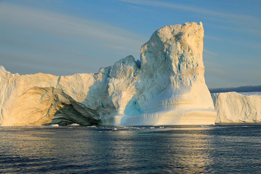 Icebergs in the Icefjord in the warm light of the midnight sun Photograph by Rainer Grosskopf