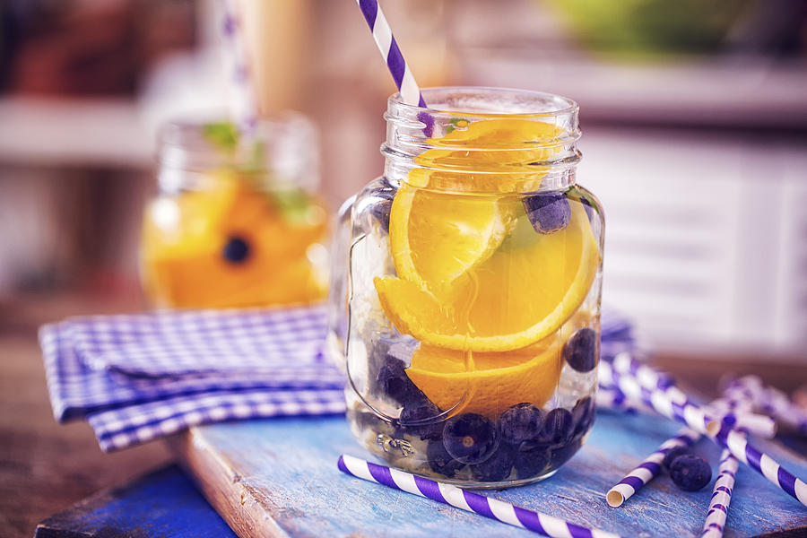 Infused Water with Fresh Blueberries and Oranges Photograph by GMVozd