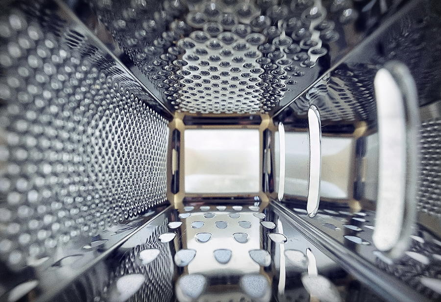 Inner view of a steel grater in the kitchen. Photograph by Emreturanphoto