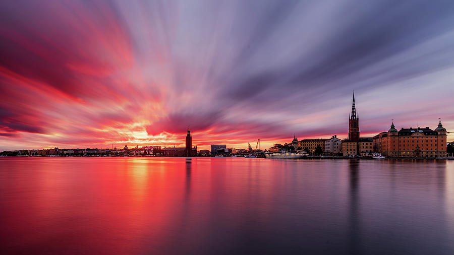 Fiery Photograph - Insane Red and Purple long exposure sunset over Stockholm by Dejan Kostic