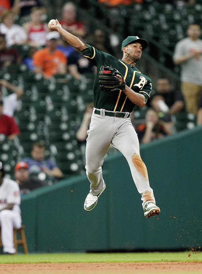 Jake Marisnick and Marcus Semien Photograph by Bob Levey