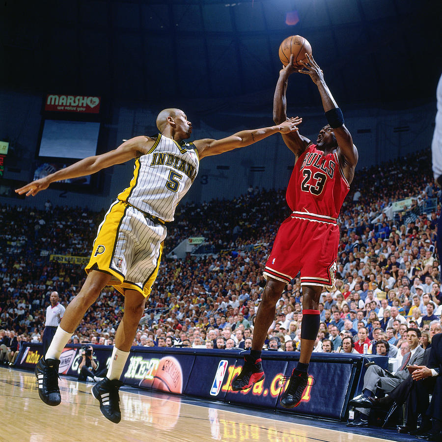 Jalen Rose and Michael Jordan Photograph by Nathaniel S. Butler